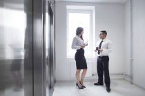 Colleagues talking in corridor — Stock Photo