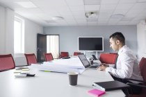 Man working in empty room — Stock Photo