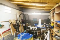 Messy garage with tools interior — Stock Photo