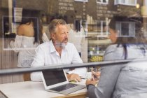 Senior man and mature woman talking in cafe — Stock Photo