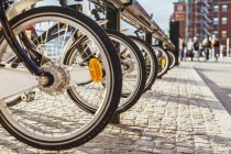 Row of bicycles at rental station — Stock Photo