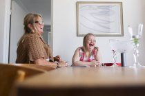 Mother and daughter with down syndrome playing game — Stock Photo