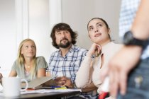 Coworkers listening during business meeting — Stock Photo