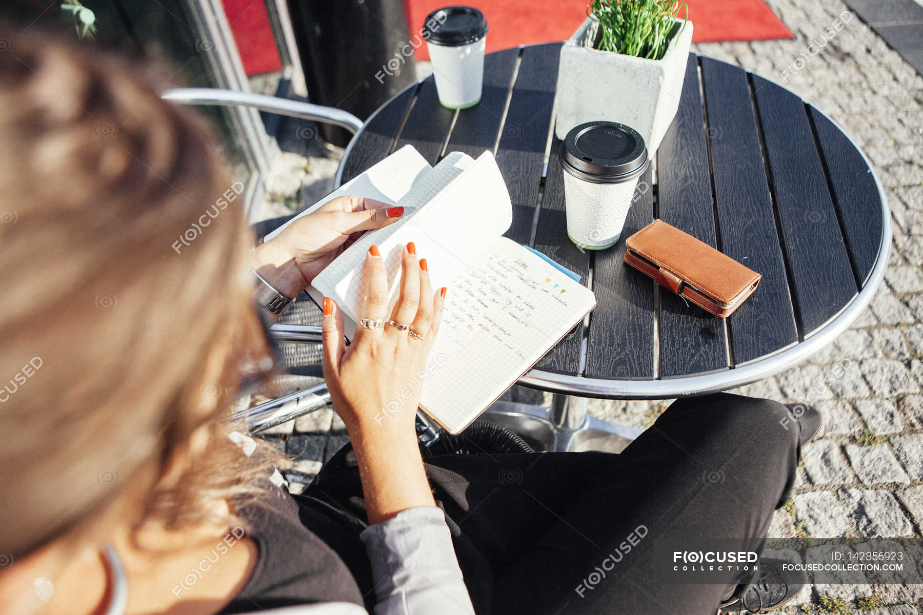 Businesswoman Reading Diary At Sidewalk Cafe Expertise Fashion Designer Stock Photo 142856923