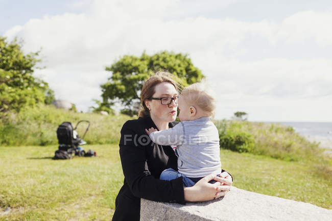 Mother with son on field — Stock Photo