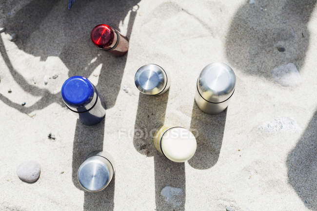 Bottles on sand at beach — Stock Photo