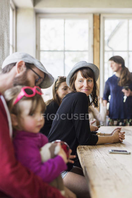 Woman looking at family — Stock Photo