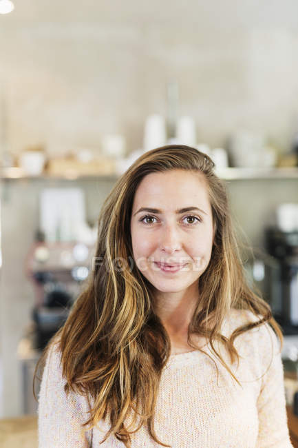 Smiling woman in restaurant — Stock Photo