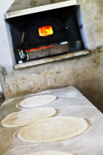 Fresh pizzas layers on counter — Stock Photo