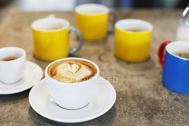 Fresh cappuccino with heart shape froth — Stock Photo