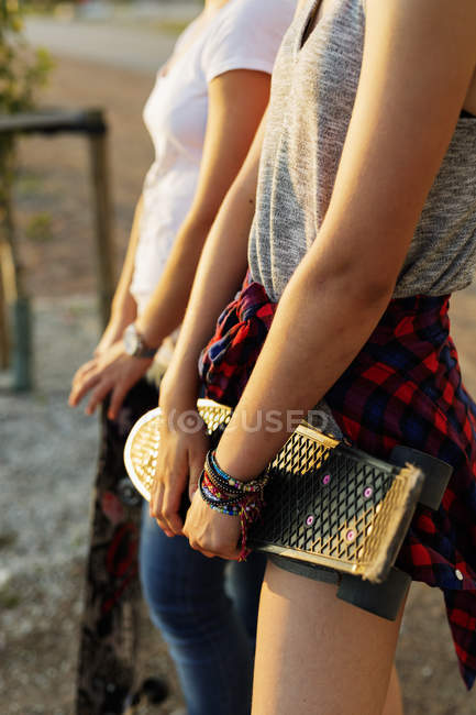 Teenage friends with skateboards at skate park — Stock Photo