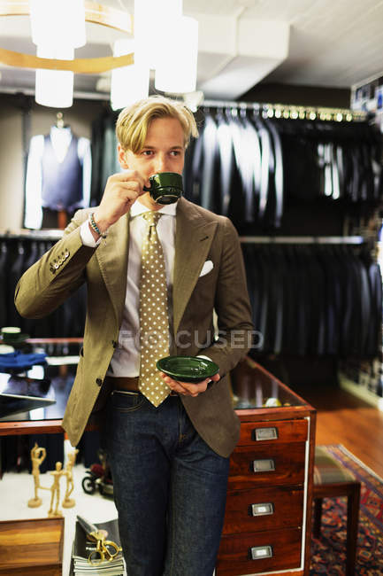 Handsome owner in clothing store — Stock Photo