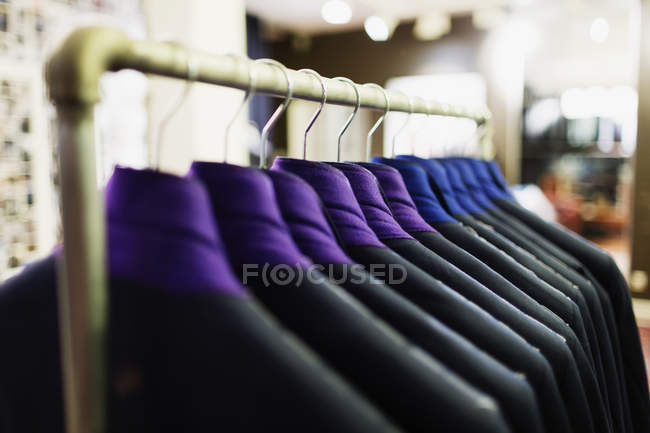 Suits hanging on rack — Stock Photo