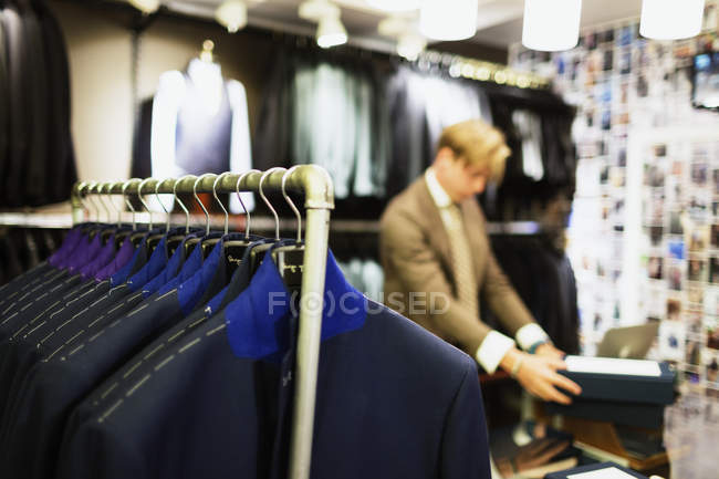 Designer working at clothing store — Stock Photo