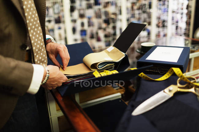 Fashion designer choosing fabric — Stock Photo