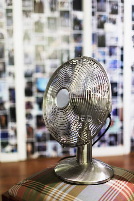 Electric fan on stool — Stock Photo
