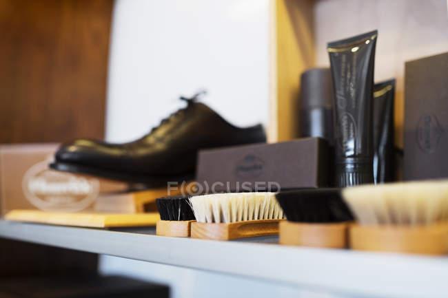 Shoe polish brushes on shelf — Stock Photo