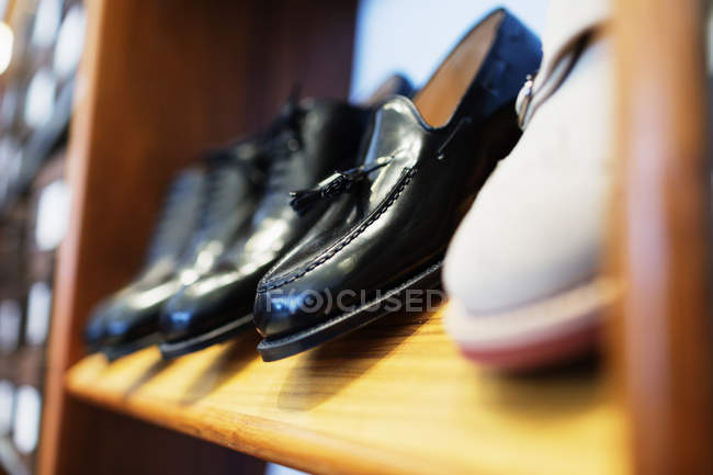 Formal shoes arranged in shelf — Stock Photo