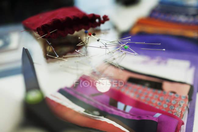 Thumbtacks on glass table — Stock Photo