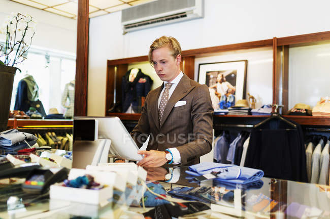 Handsome owner working on computer — Stock Photo