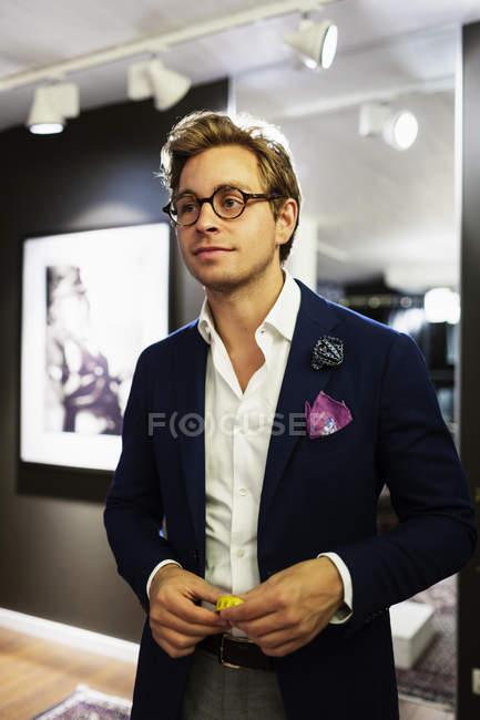 Designer standing in clothing showroom — Stock Photo