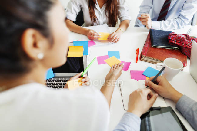 Colleagues discussing on desk at office — Stock Photo