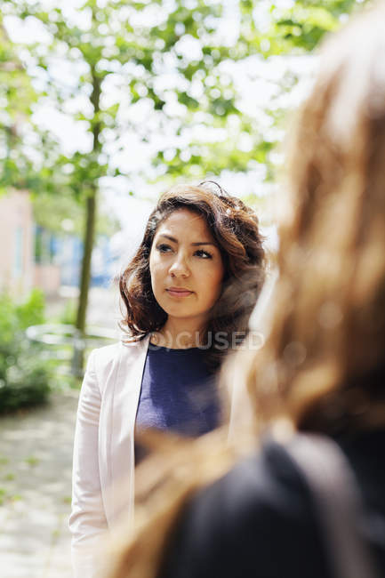 Beautiful businesswoman with colleague — Stock Photo