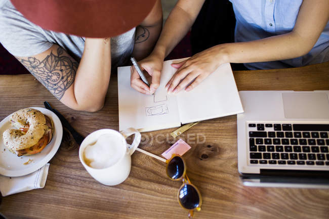 Freelancers making plan at cafe — Stock Photo