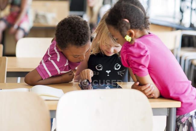 Children using digital tablet — Stock Photo