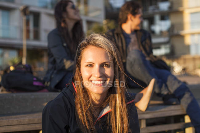 Happy woman with friends — Stock Photo