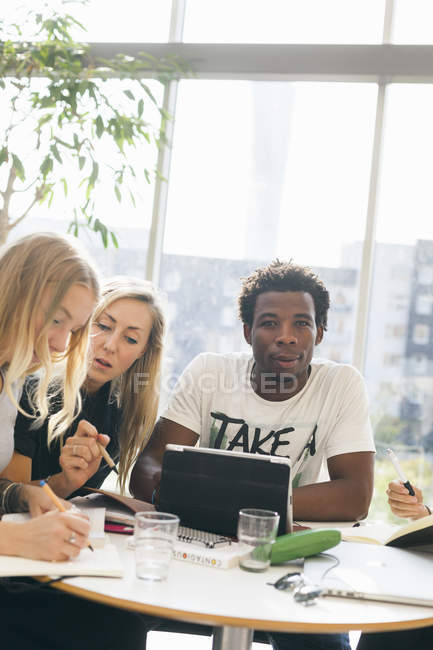 Male student with female friends — Stock Photo