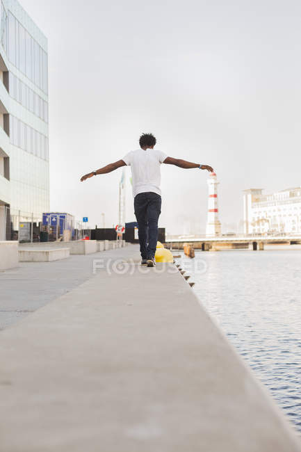 Student walking with arms outstretched — Stock Photo