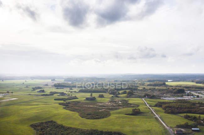 Green landscape against sky — Stock Photo