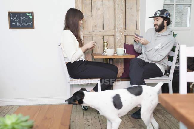 Dog walking by couple — Stock Photo