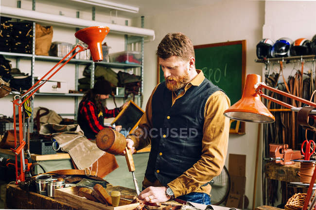 Man using mallet and chisel — Stock Photo