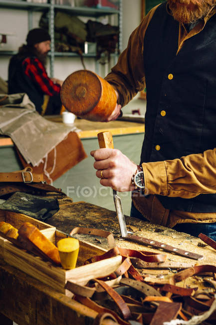 Worker using mallet — Stock Photo