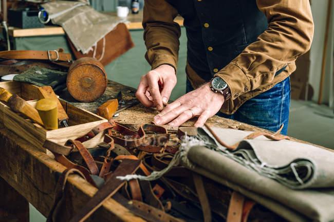Man working at workbench — Stock Photo