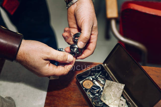 Hands holding tool in workshop — Stock Photo