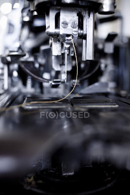 Sewing machine with needle and thread — Stock Photo