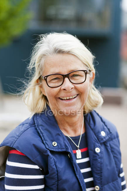 Smiling senior woman — Stock Photo