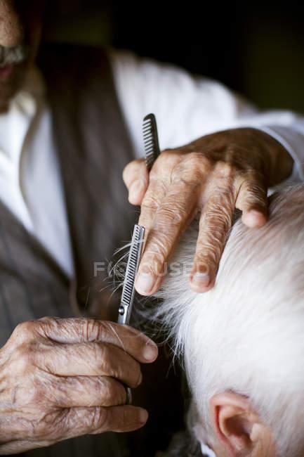 Que corte de pelo peluquería - foto de stock