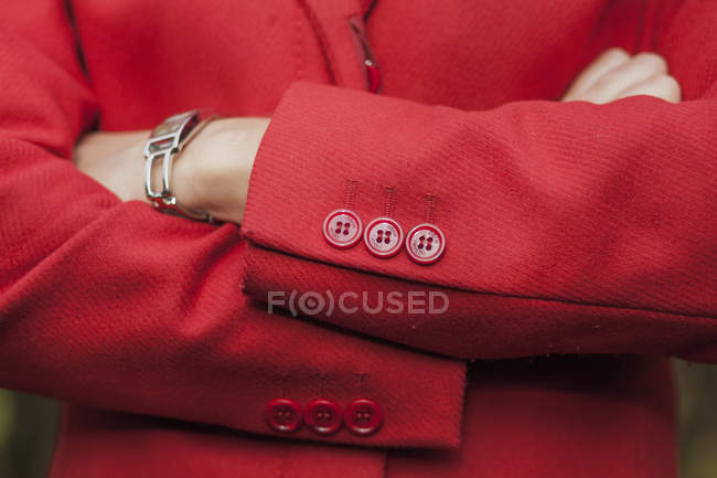 Midsection of businesswoman in red blazer — Stock Photo
