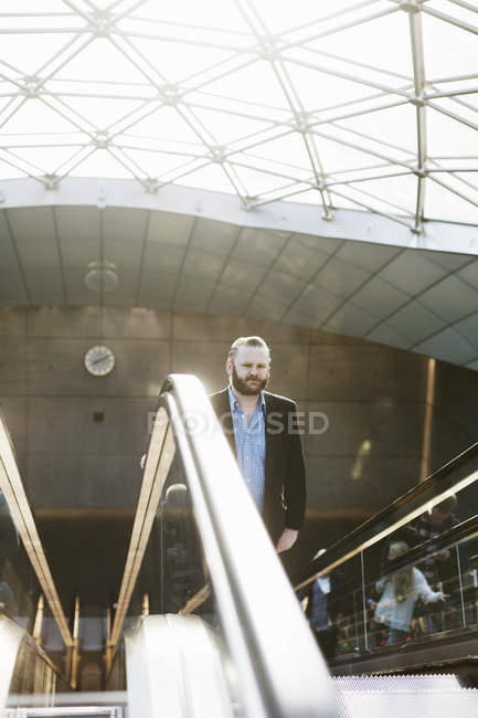 Businessman On Moving Staircase U2014 Stock Photo