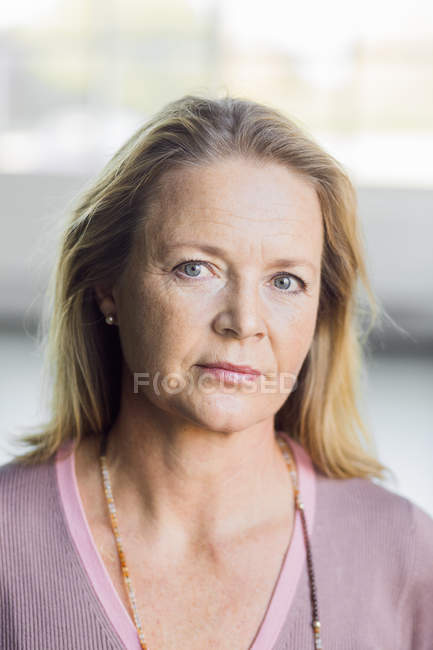 Mature woman at gym — Stock Photo