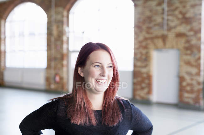 Woman smiling in health club — Stock Photo