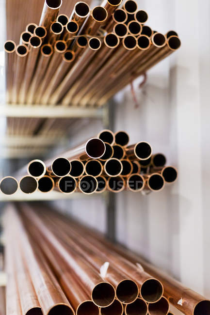 Heaps of pipes in factory — Stock Photo