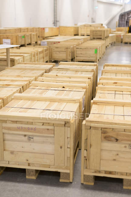 Wooden crates placed inside warehouse — Stock Photo