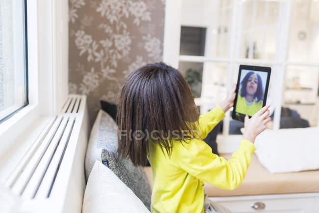Girl taking selfie through digital tablet — Stock Photo