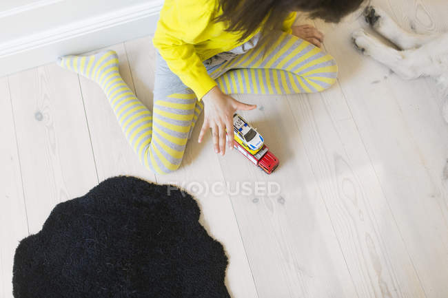 Girl playing with toy cars — Stock Photo