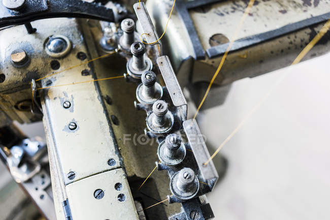 Sewing machine part in factory — Stock Photo